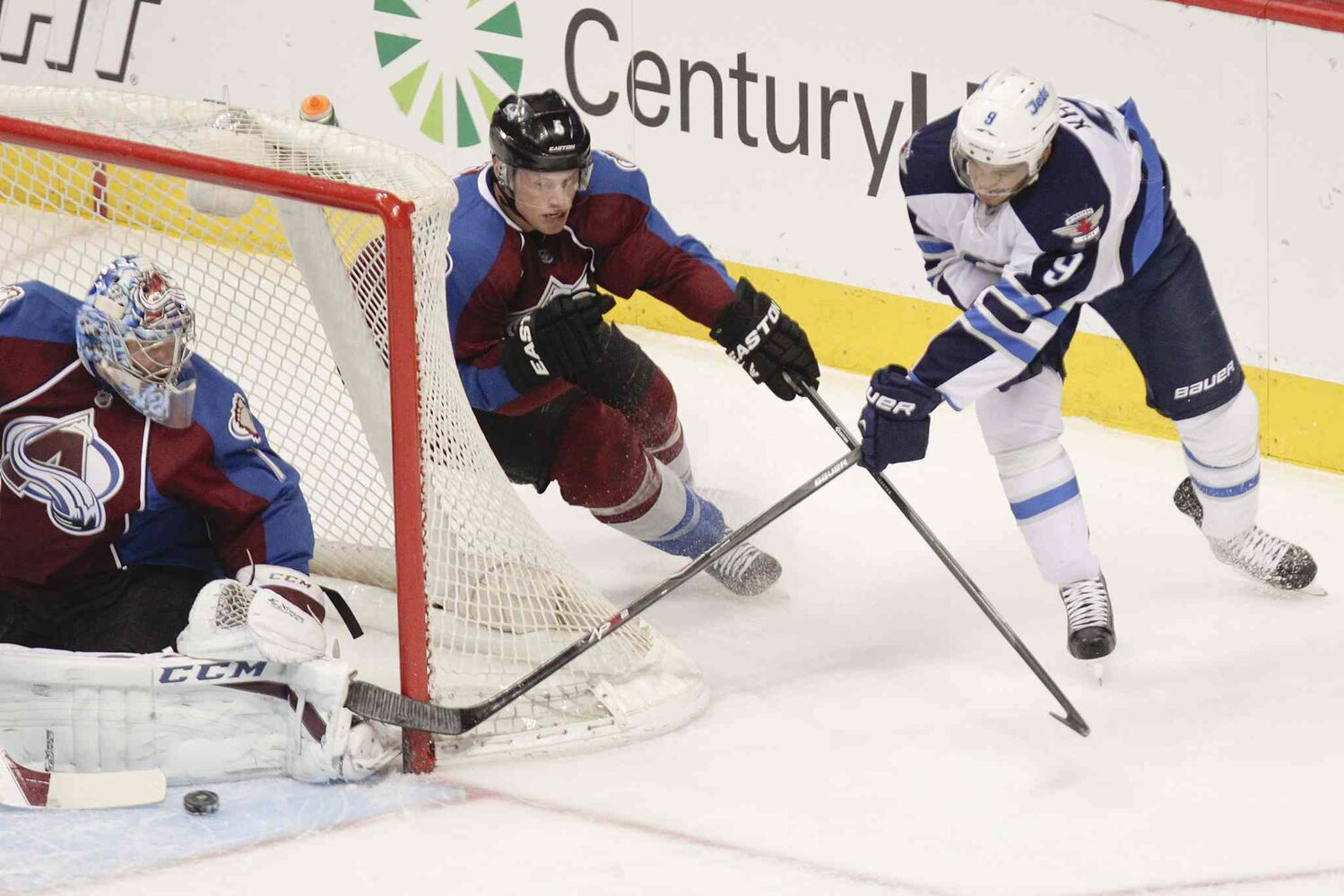 Winnipeg Jets forward Evander Kane tries a wraparound against Colorado Avalanche goalie Semyon Varlamov.