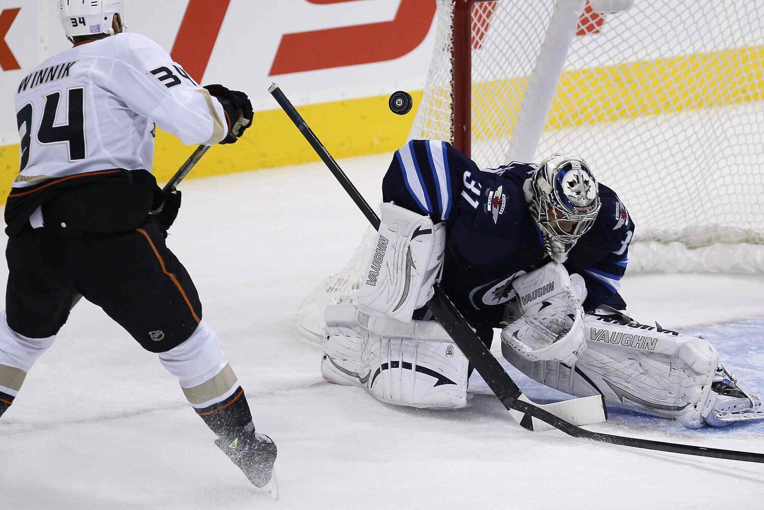 Winnipeg Jets' goaltender Ondrej Pavelec gets his shoulder on a shot from Anaheim Ducks' Daniel Winnik during the first period. (JOHN WOODS / WINNIPEG FREE PRESS)