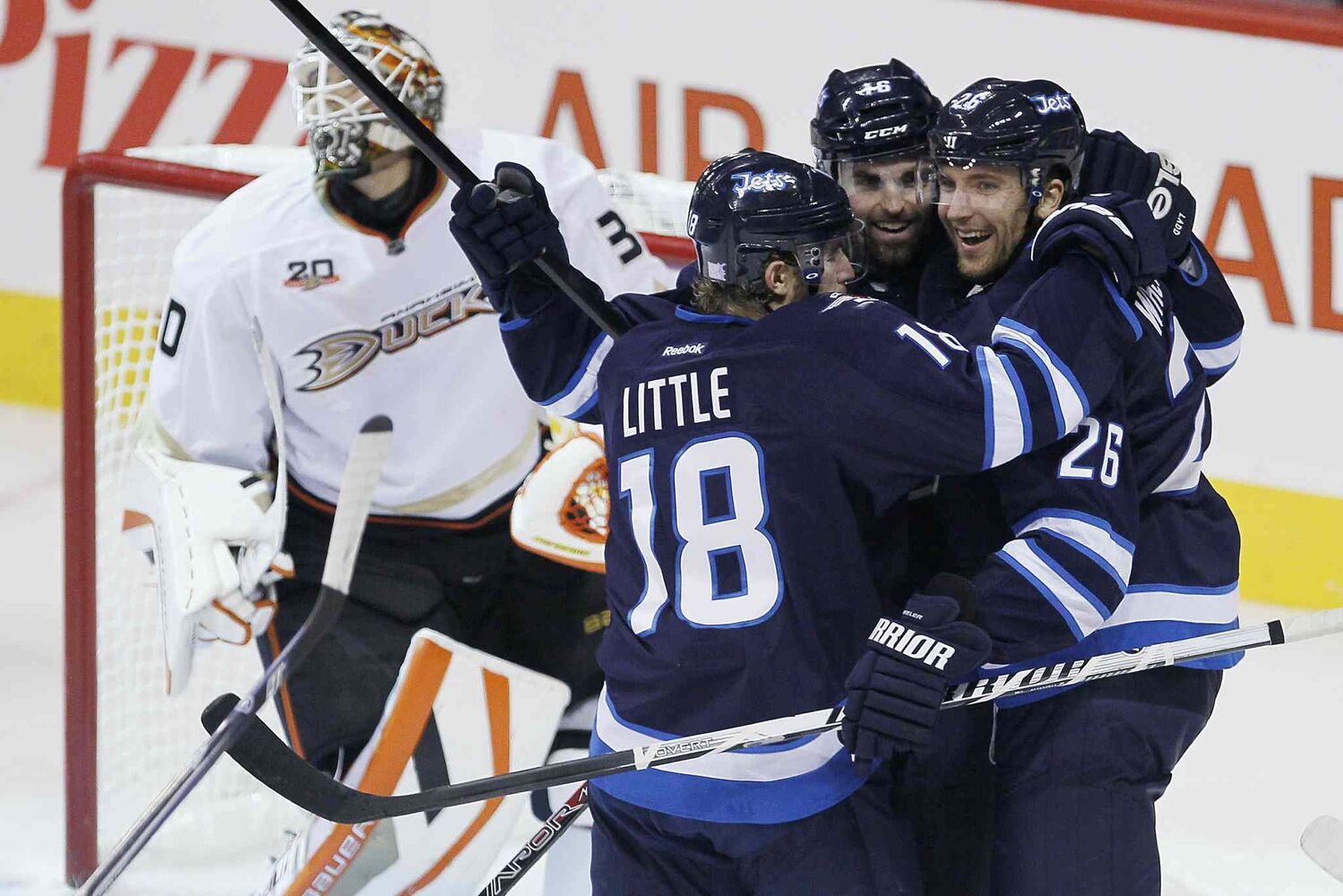 Winnipeg Jets' Bryan Little, Andrew Ladd and Blake Wheeler celebrate Ladd's goal against Anaheim Ducks' goaltender Viktor Fasth during the first period.