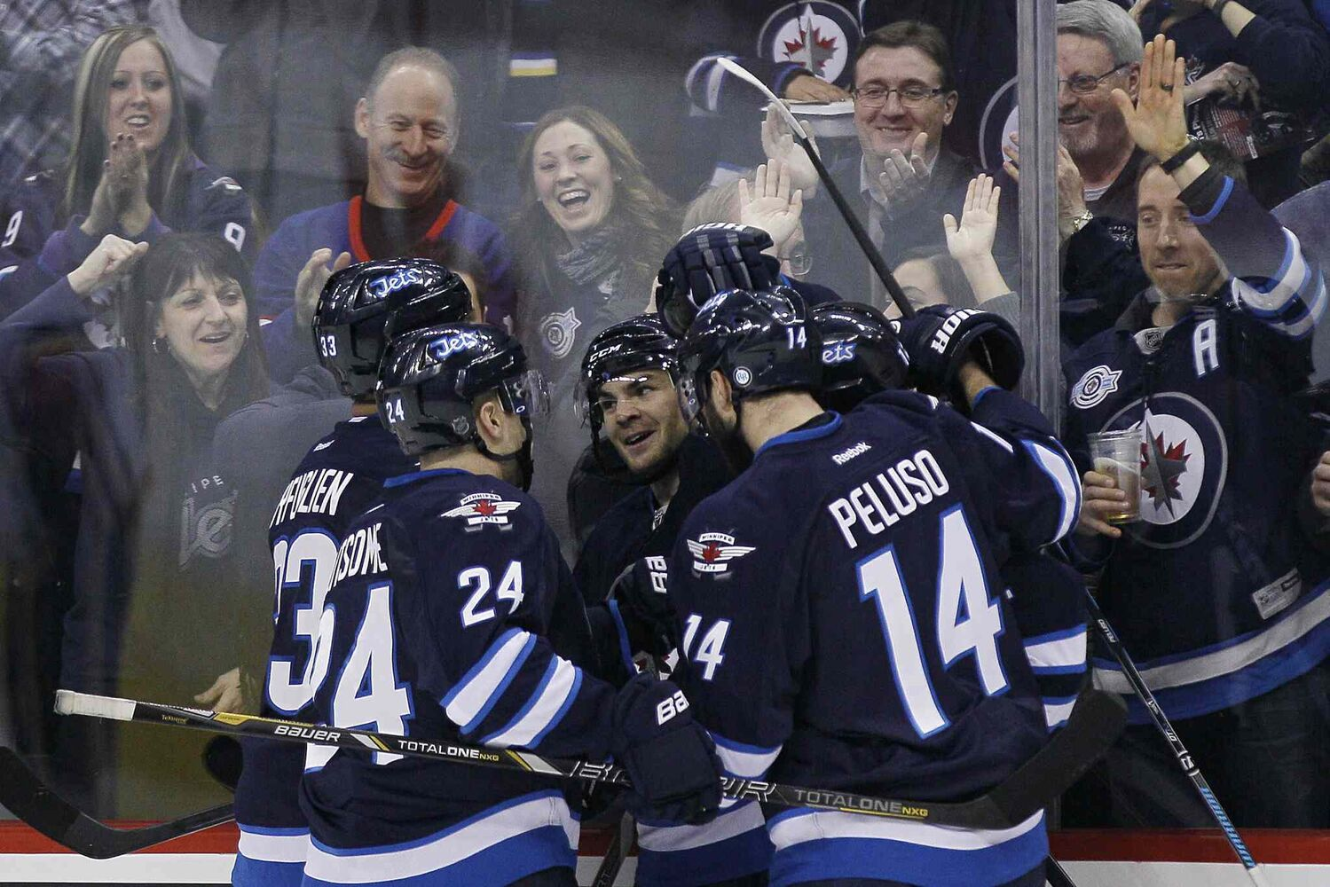 Winnipeg Jets' Dustin Byfuglien (33), Grant Clitsome (24), Michael Frolik (67), Olli Jokinen (12) and Anthony Peluso (14) celebrate Frolik's goal against the Calgary Flames during second period NHL action in Winnipeg on Monday, Nov. 18, 2013.