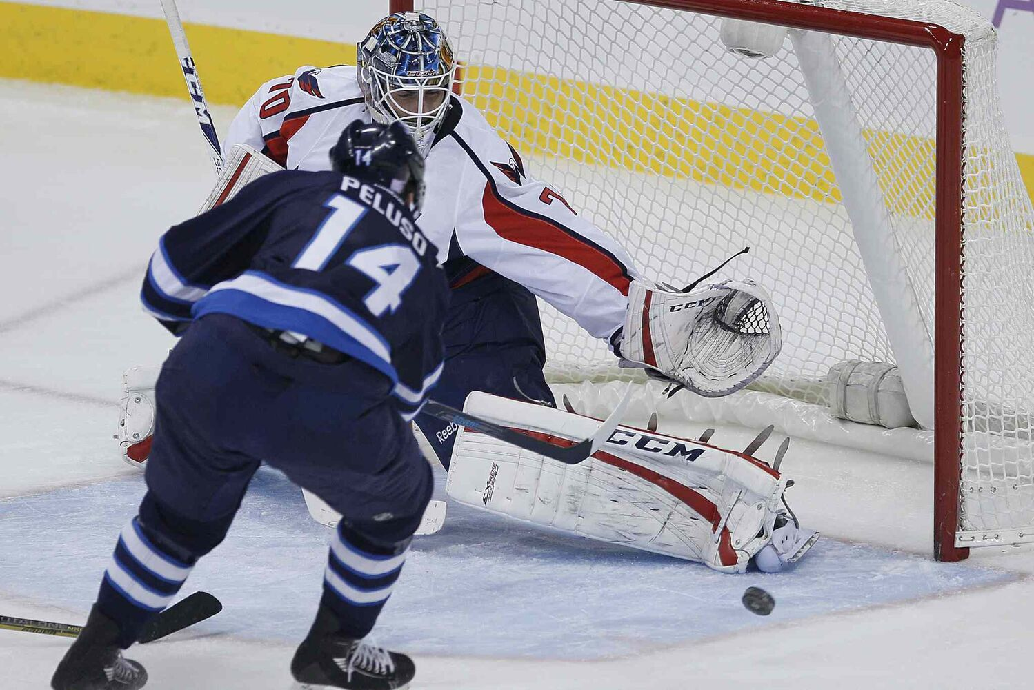 Winnipeg Jets forward Anthony Peluso misses this opportunity to score on Washington Capitals goaltender Braden Holtby during the first period.