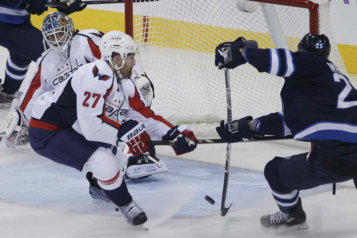 Winnipeg Jets forward Blake Wheeler misses this opportunity to score on Washington Capitals goaltender Braden Holtby as Capitals defenceman Karl Alzner defends.