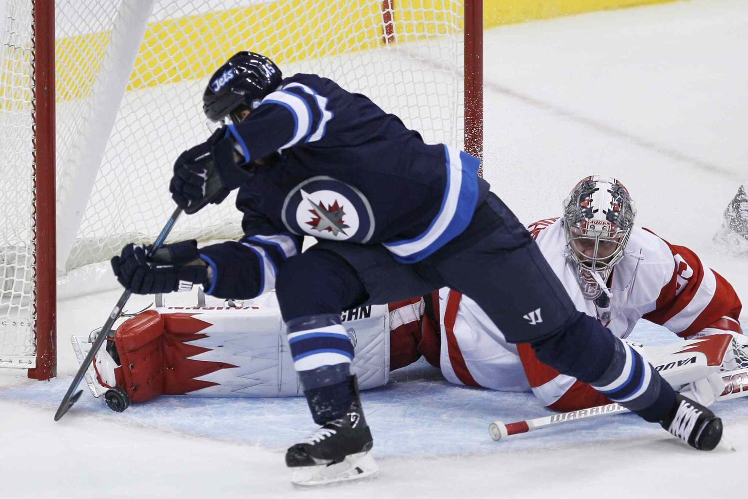 Winnipeg Jets forward Matt Halishchuk is stopped by Detroit Red Wings goaltender Jimmy Howard in the first period.