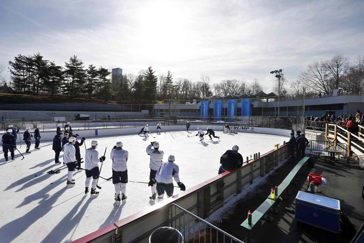 The Winnipeg Jets run a drill during a practice at Lasker rink in New York's Central Park on Saturday.