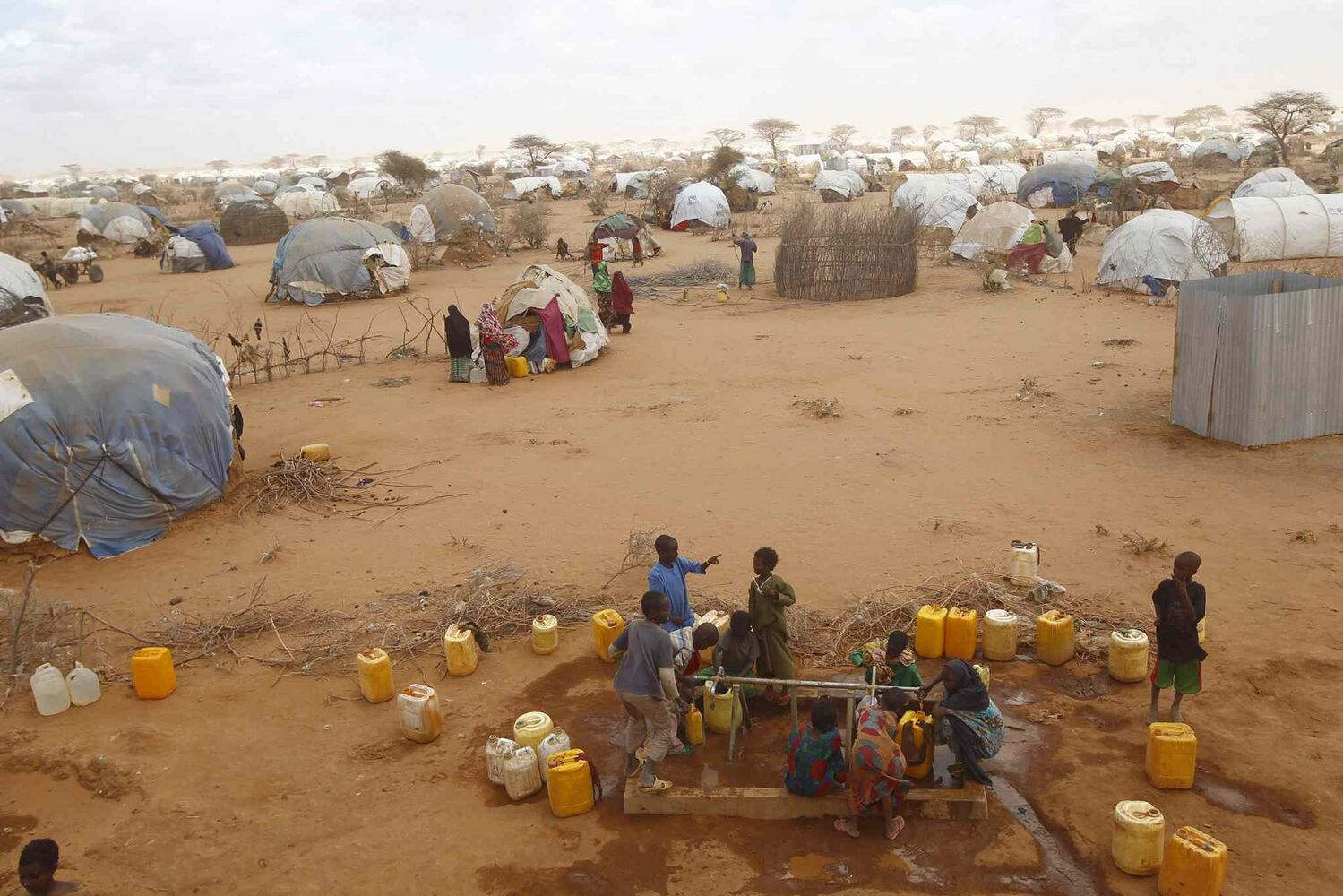 In this photo taken in August, 2011, Somali refugees collect water at the LFO refugee camp outside Dadaab, eastern Kenya, 100 kilometers from the Somali border. Built in 1991 for 90,000 people, the camp has swelled to more than 400,000 registered refugees because of Somalia's long-running conflict and now its famine. Another 40,000 are waiting for official registration.