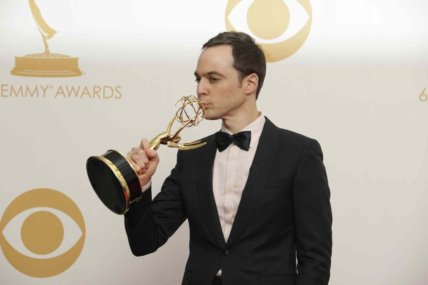 Jim Parsons kisses his Emmy backstage the 65th annual Primetime Emmy Awards on Sunday in Los Angeles. Parsons again claiming the top comedy acting trophy for The Big Bang Theory. Parsons added to the awards he won in 2011 and 2010 for the role of a science nerd.