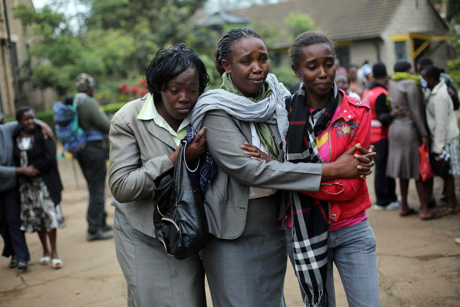 Relatives of Johnny Mutinda Musango, 48, weep after identifying his body at the city morgue in Nairobi, Kenya, Tuesday. Musango was one of the victims of the Westgate Mall hostage siege. Kenyan security forces were still combing the Mall on the fourth day of the siege by al-Qaida-linked terrorists.  (Jerome Daly / The Associated Press)