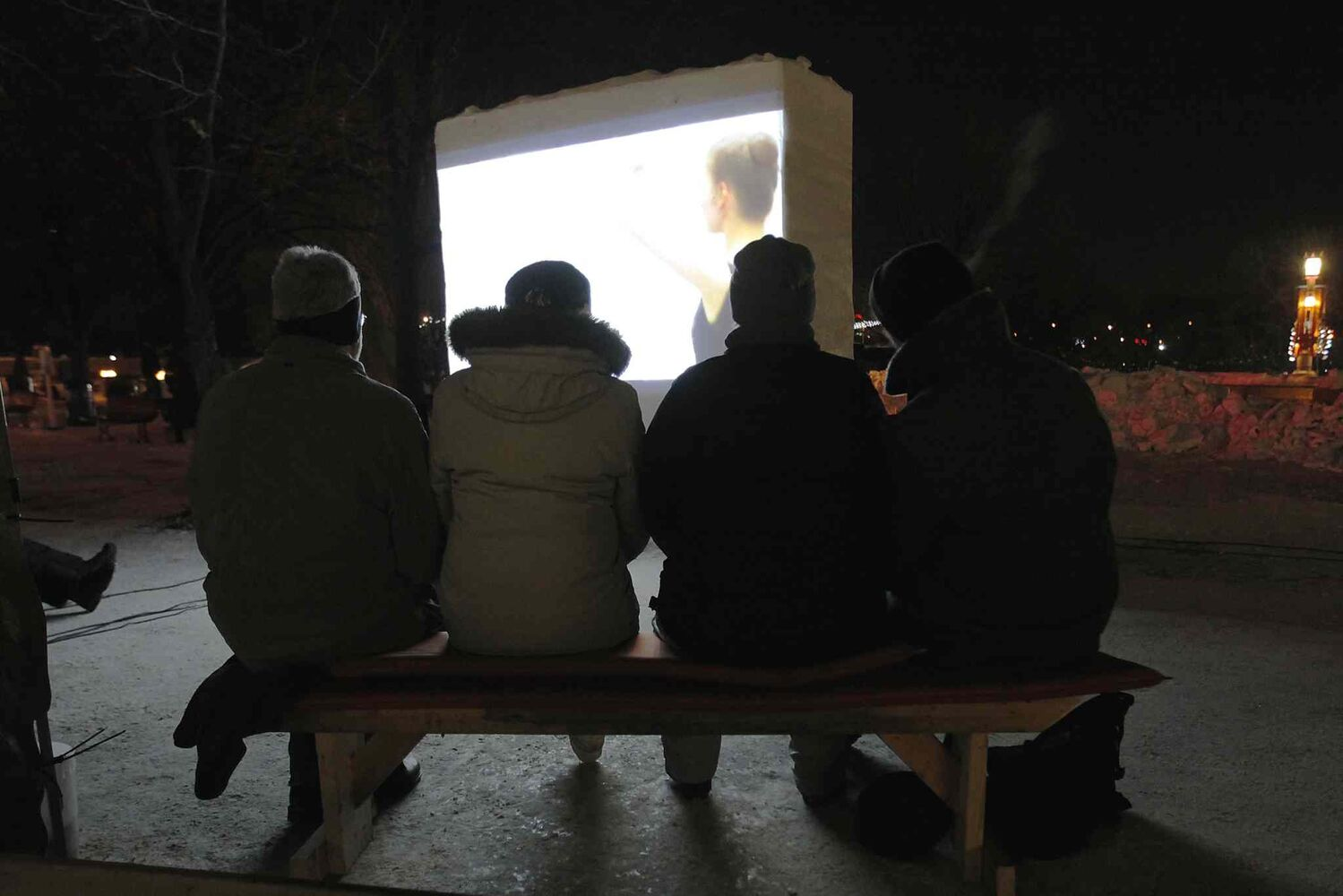People watch a movie during the Canadian Sport Film Festival.