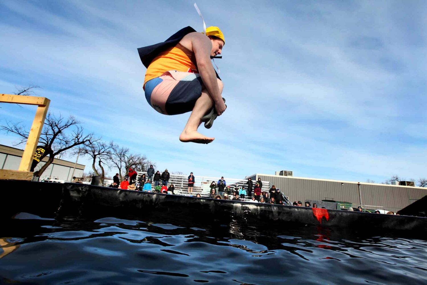 Darren Anderson does a cannonball jump into a BFI bin filled with water at the Indian Metis Friendship Centre Saturday afternoon as part of the Polar Plunge, a fundraiser for Special Olympics Manitoba.  (Ruth Bonneville / Winnipeg Free Press)