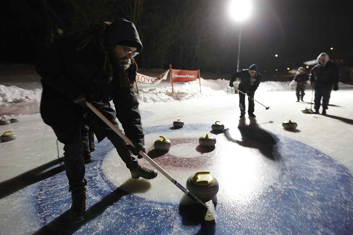 Mitchell Braun of the Short and Curlies curls against the Tequila Shots at the 13th annual Ironman Outdoor Curling Bonspiel at The Forks Saturday.