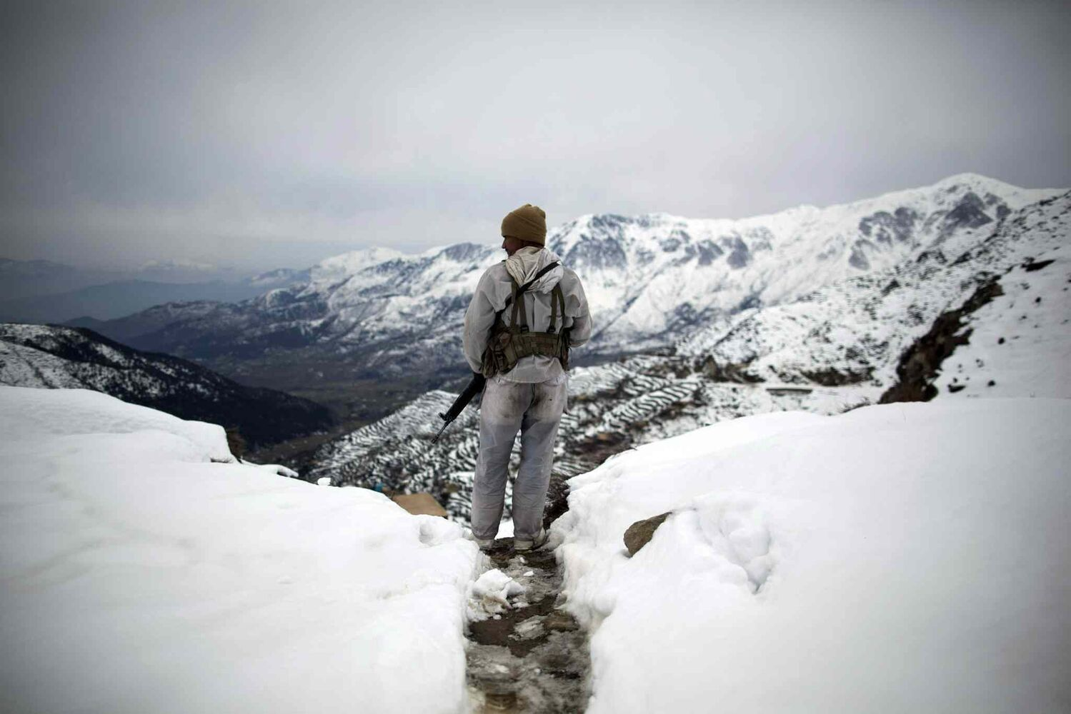 Feb. 17, 2012: A Pakistani Army soldier with the 20th Lancers Armored Regiment stands atop the 8000-foot mountain during a patrol near his outpost, Kalpani Base, in Pakistan's Dir province on the Pakistan-Afghan border.