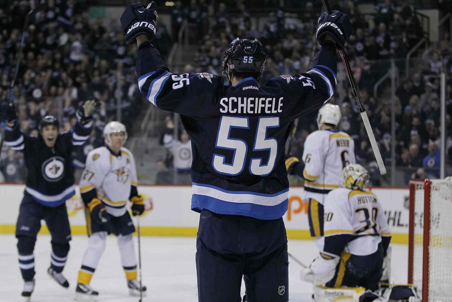 Winnipeg Jets' Mark Scheifele (55) celebrates his second-period goal on Nashville Predators' goaltender Carter Hutton (30) during Tuesday's game in Winnipeg. (John Woods / Winnipeg Free Press)