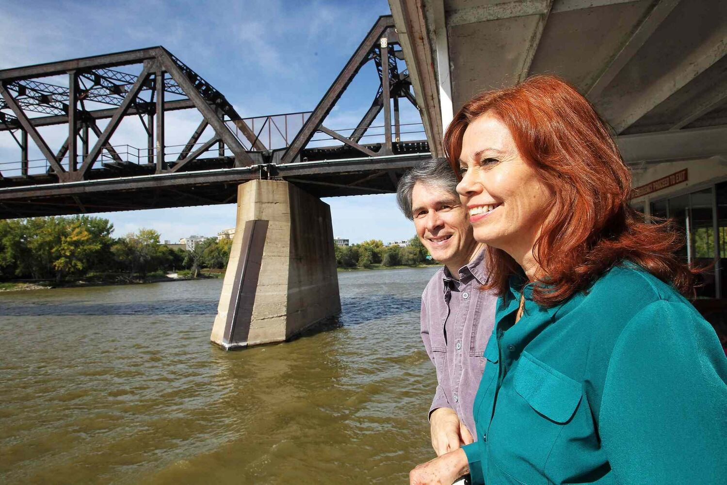 Brian and Nancy Drews, on seventh wedding anniversary, watch Winnipeg's skyline as the Paddlewheel Queen cruised the Red River for the last time this year. The couple had their wedding reception on the Paddlewheel Queen seven years ago.  (Mike Deal / Winnipeg Free Press)