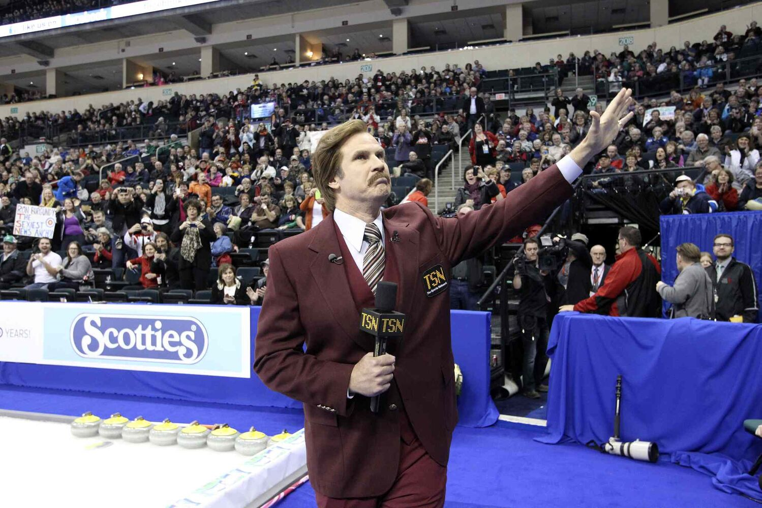 Ron Burgundy waves to his fans during the opening ceremony.