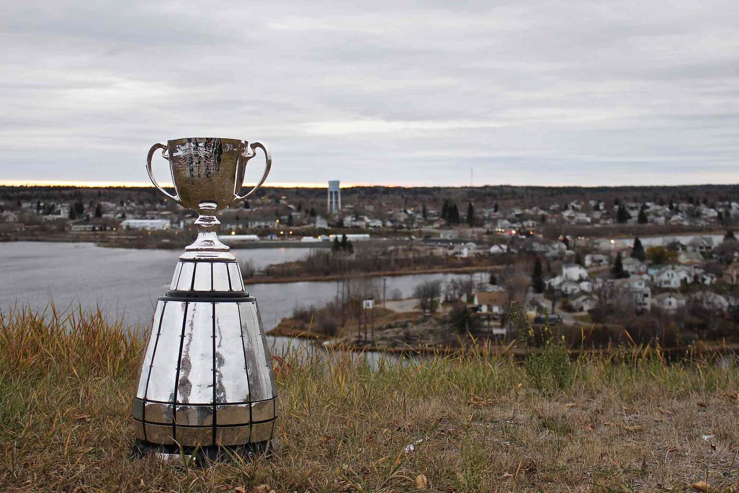 The Grey Cup overlooking the town of Flin Flon. The trophy was in town as part of an eight-day tour through northern Manitoba to help promote the Grey Cup game in Winnipeg this year. (Jeff Hamilton / Winnipeg Free Press)