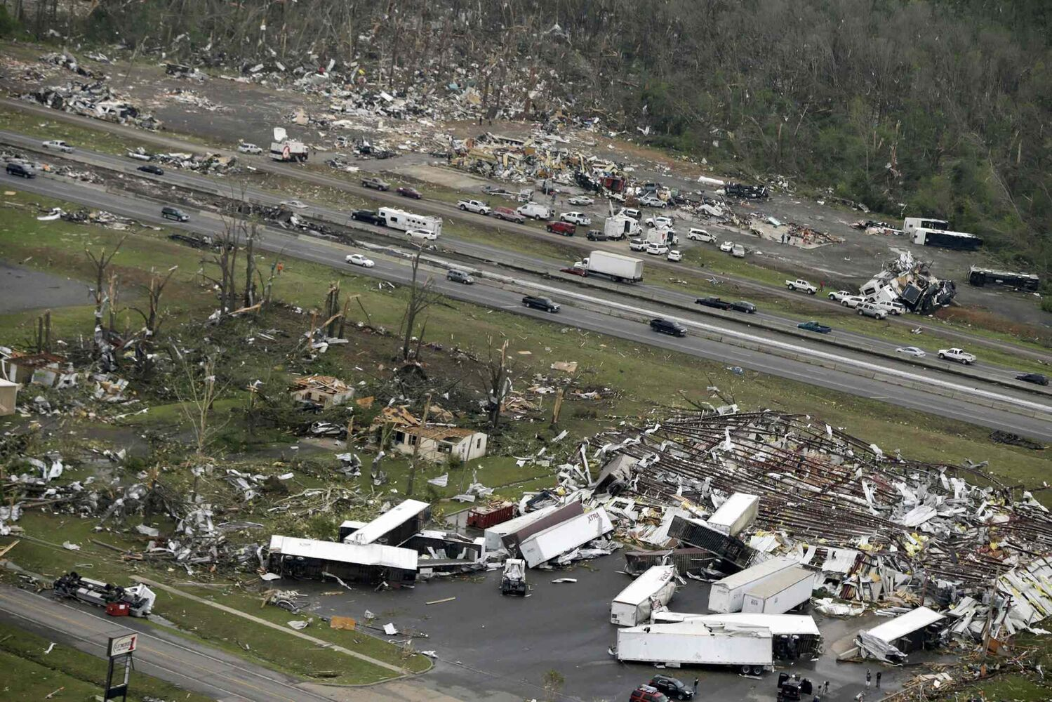 Traffic passes on Interstate 40 between destroyed businesses in Mayflower, Ark., Monday, April 28, 2014. (Danny Johnston / The Associated Press)