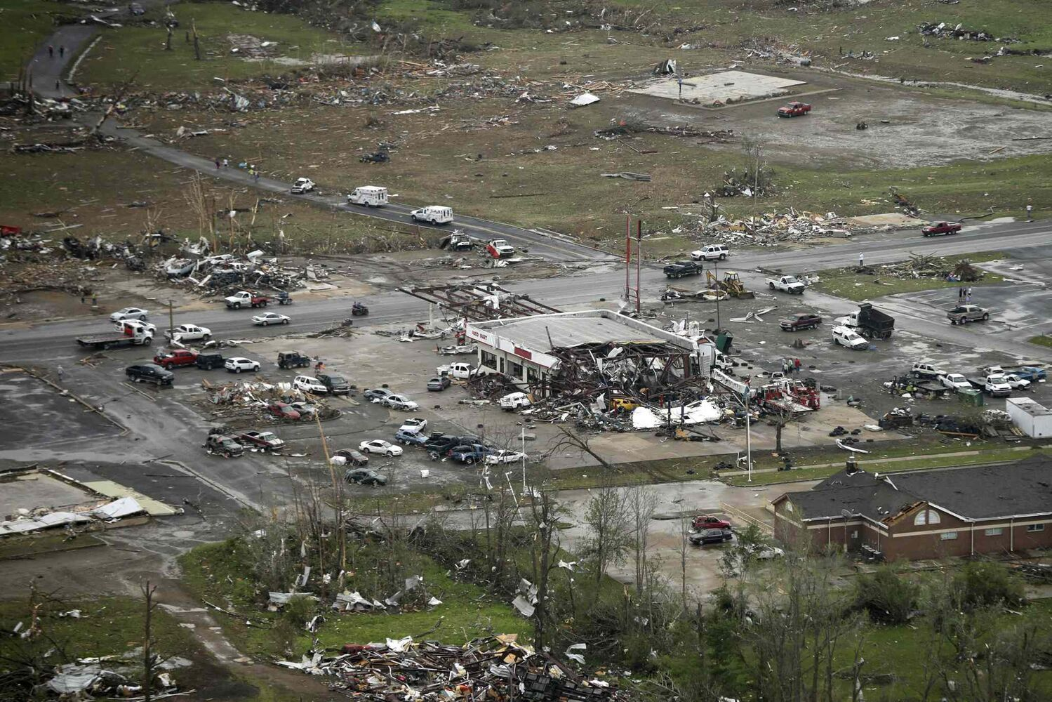 A storm-damaged convenience store, center, sits among rubble along U.S. Highway 64 in Vilonia, Ark., Monday, April 28, 2014, after a tornado struck the town late Sunday.  (Danny Johnston / The Associated Press)