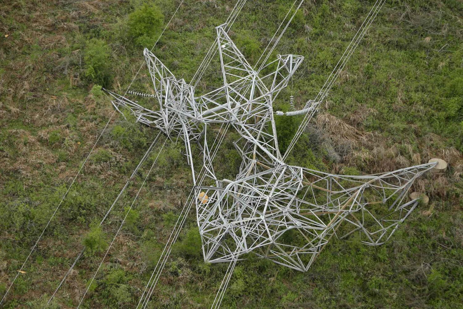 A twisted power distribution line tower is crumpled on the ground near Mayflower, Ark., Monday, April 28, 2014 after a tornado struck the town late Sunday.  (Danny Johnston / The Associated Press)