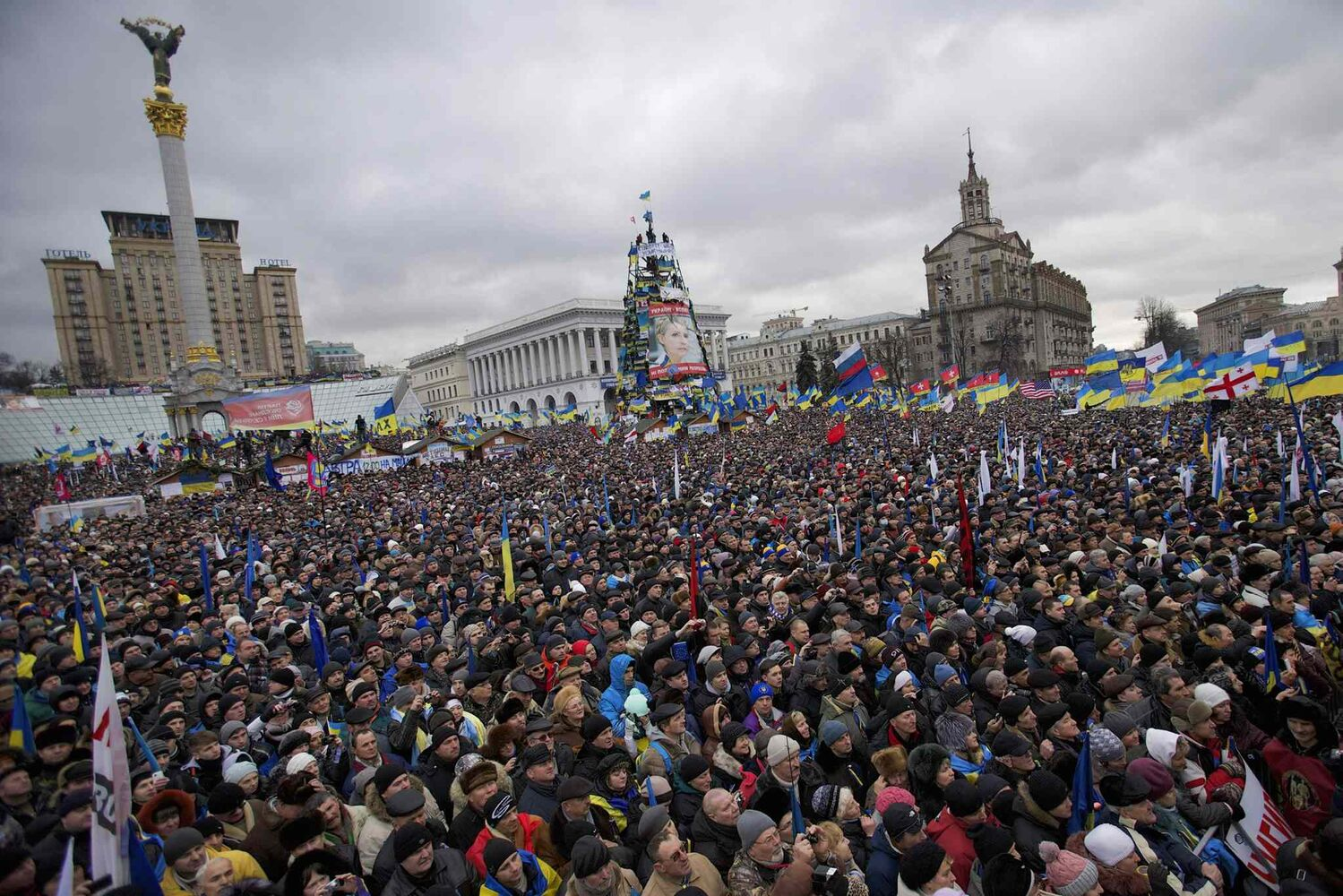 Independence Square is flooded with more than 200,000 angry Ukrainians Sunday. (The Associated Press)