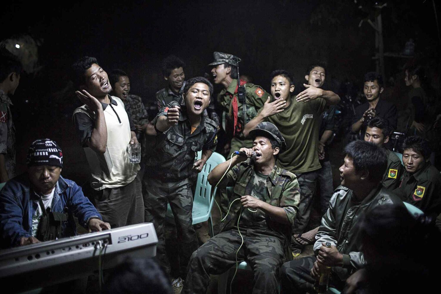 First prize in the Daily Life Single category by Julius Schrank of Germany<p>   Kachin Independence Army fighters drink and celebrate at a funeral of one of their commanders who died the day before in Burma on March 15, 2013.  (Julius Schrank, De Volkskrant)