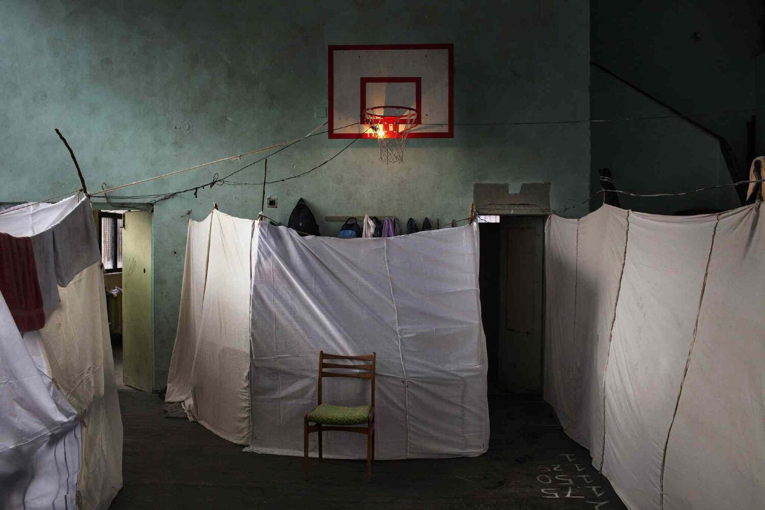 First prize in the General News Single category by Alessandro Penso of Italy<p> Military Ramp, an emergency refugee centre in an abandoned school in Sofia, Bulgaria, provides housing for about 800 Syrian refugees, including 390 children. Pictured Nov. 21, 2013. (Alessandro Penso, OnOff Picture)