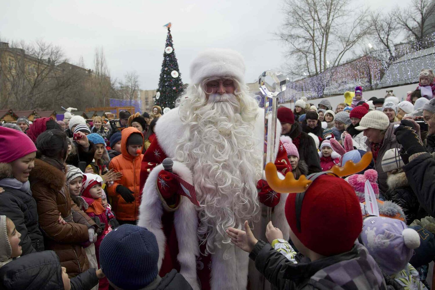 Children surround Russian Ded Moroz (Father Frost), who arrived at the Moscow Zoo as a part of a New Year celebrations, in Moscow, Russia, on Wednesday, Dec. 25, 2013. Russians celebrate Orthodox Christmas on Jan. 7. (The Canadian Press)