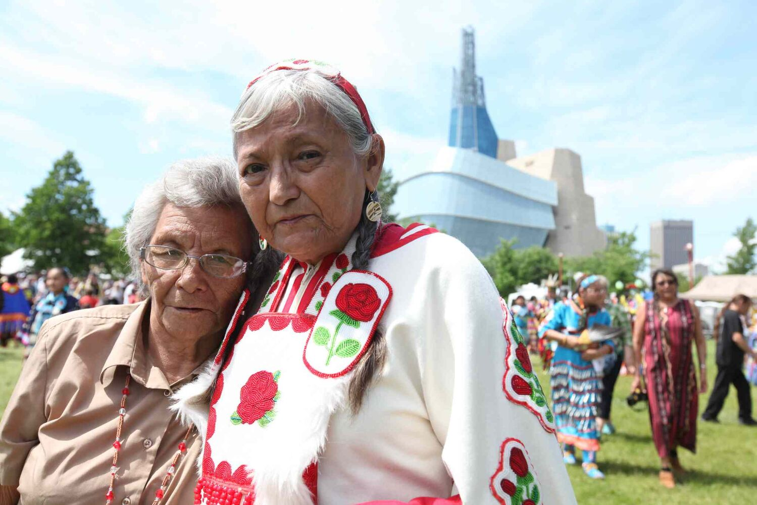 Gloria Chocan, right, and her sister Rosalie Chokin of Onion Lake Cree Nation attend the powwow on the  fields at the Forks National Historic site during National Aboriginal Day celebrations. Chocan, along with 10 other Cree elders, is trying to get the federal government to notice the issues facing their people by travelling from Ottawa to their reservation in Alberta. (Ruth Bonneville / Winnipeg Free Press)