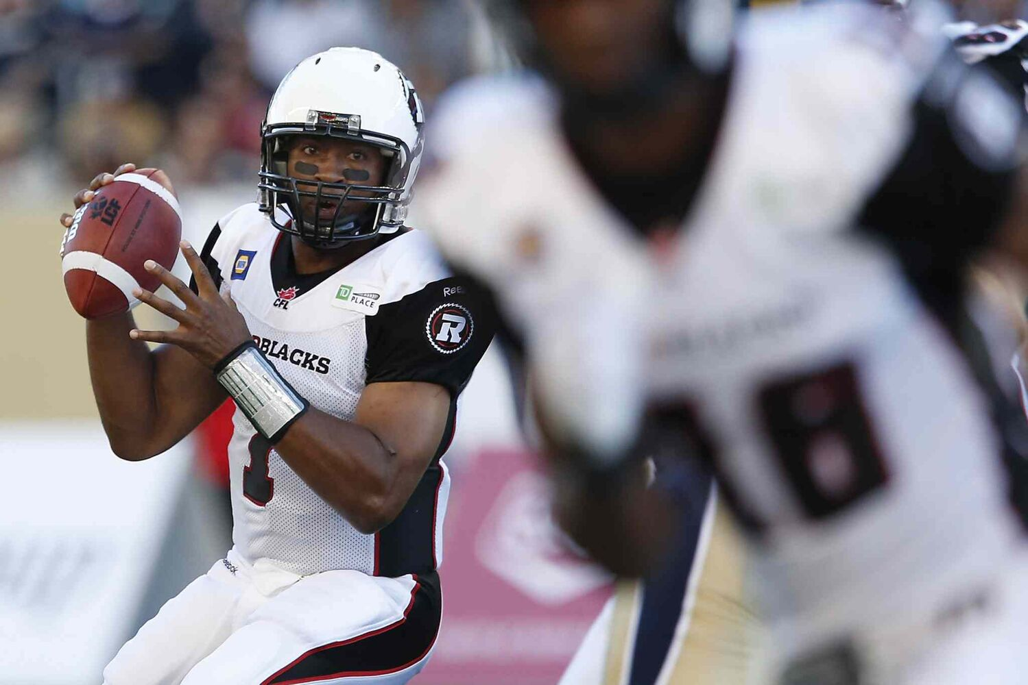 Ottawa Redblacks' quarterback Henry Burris (1) gets set to throw against the Winnipeg Blue Bombers during the first half of Thursday's game at Investors Group Field. (John Woods / The Canadian Press)
