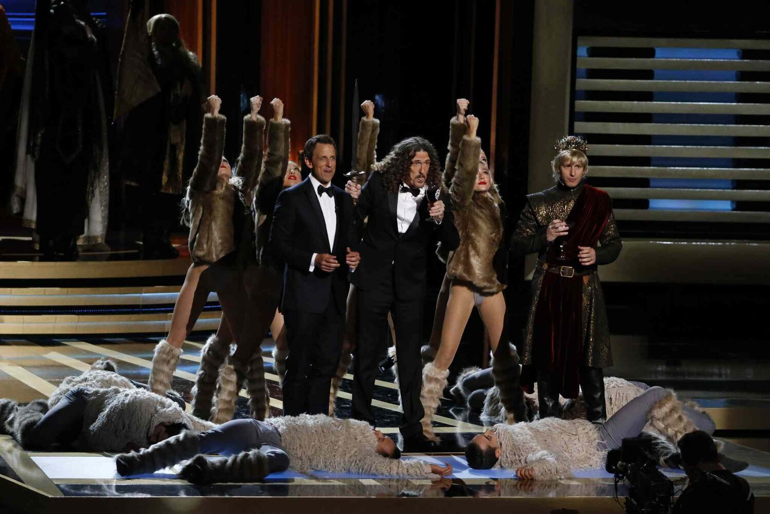 Weird Al Yankovic performs with Emmy host Seth Meyers during the 66th Annual Primetime Emmy Awards.