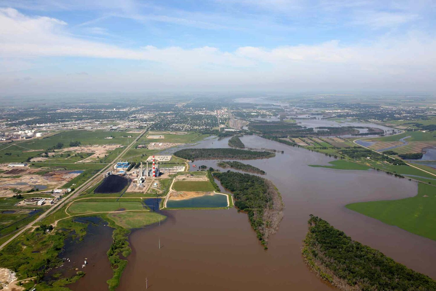 Flood water covers the Assiniboine River Valley just east of Brandon on Saturday morning, hours ahead of the expected first crest.  (Tim Smith / Brandon Sun)