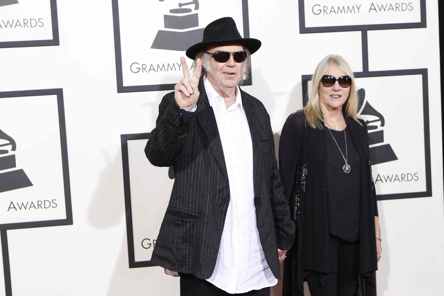 Neil Young and his wife Pegi arrive at the 56th Annual Grammy Awards.