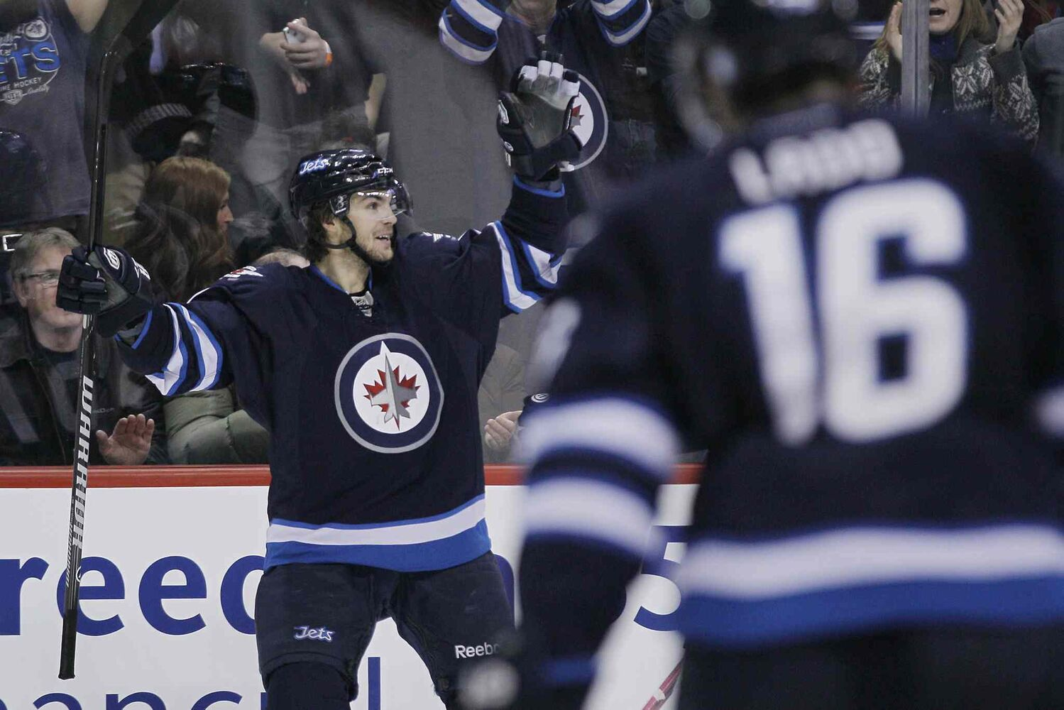 Winnipeg Jets' Michael Frolik (67) celebrates his goal against the Florida Panthers as Andrew Ladd (16) skates by during second period.