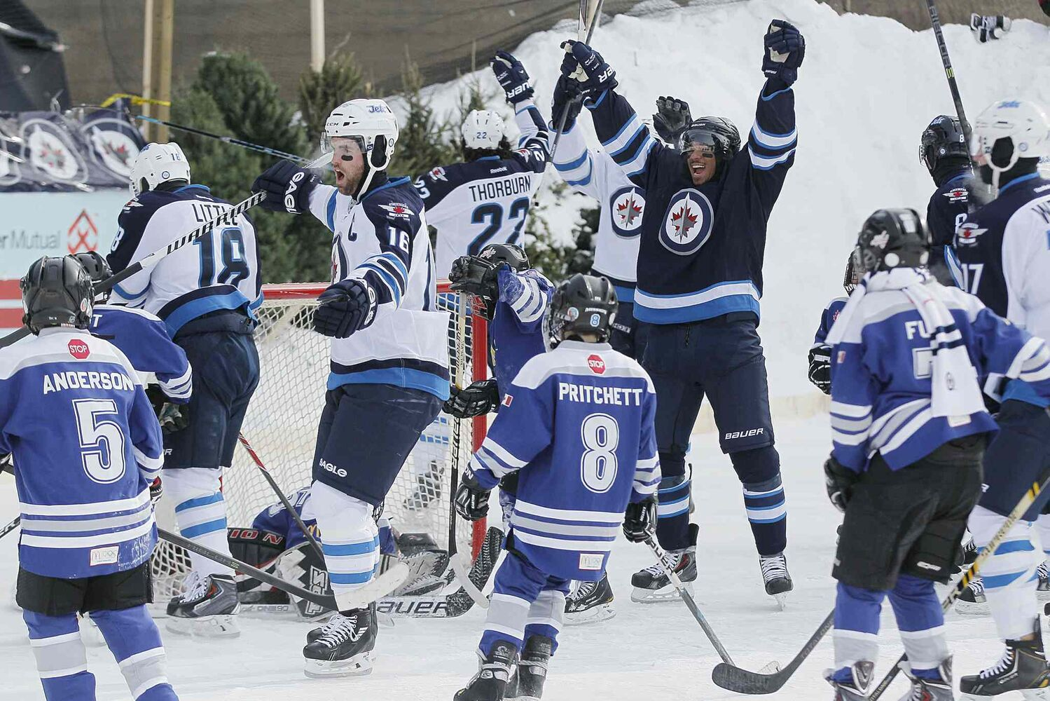 Jets sniper Evander Kane celebrates after scoring on the Portage Atom A team during the Jets' outdoor practice at The Forks on Sunday. (John Woods / Winnipeg Free Press)