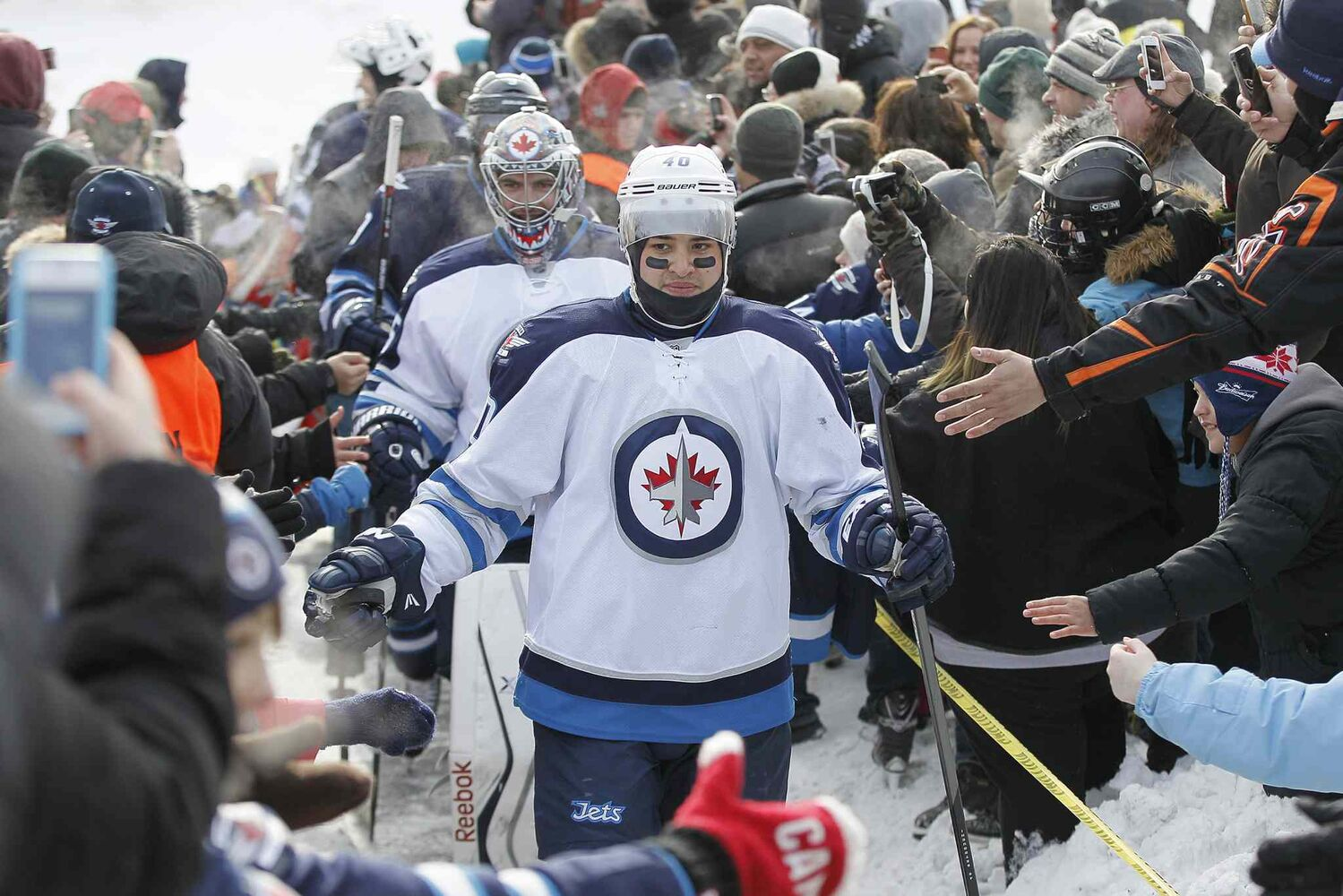 Jets forward Devin Setoguchi and goaltender Al Montoya greet fans at The Forks on Sunday. (John Woods / Winnipeg Free Press)