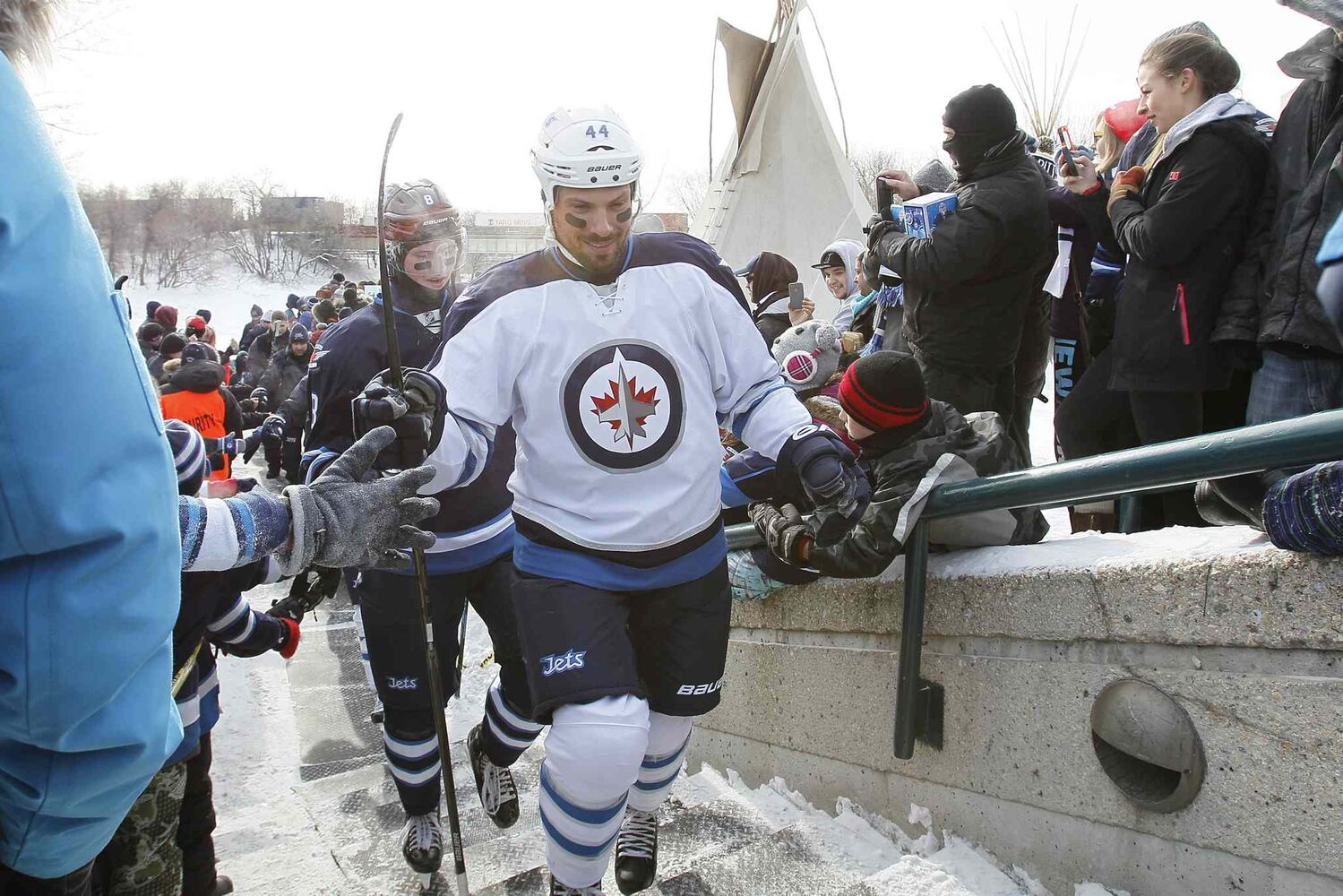 Jets defencemen Zach Bogosian (44) and Jacob Trouba (8) greet fans at The Forks on Sunday. (Winnipeg Free Press)