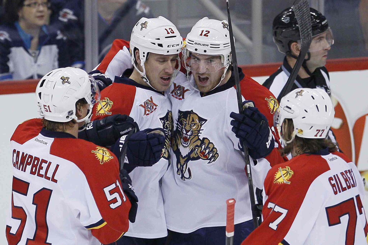 Florida Panthers' Brian Campbell (51), Shawn Matthias (18), Jimmy Hayes (12) and Tom Gilbert (77) celebrate goal Matthias' goal against the Winnipeg Jets during the first period. (John Woods / The Canadian Press)