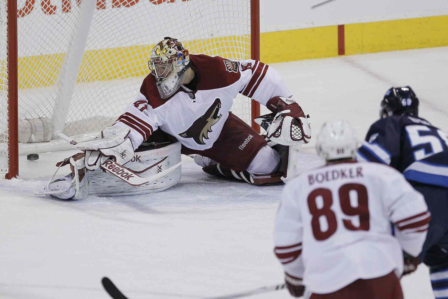 Eric O'Dell scores the Jets second goal on Phoenix Coyotes' goaltender Mike Smith.