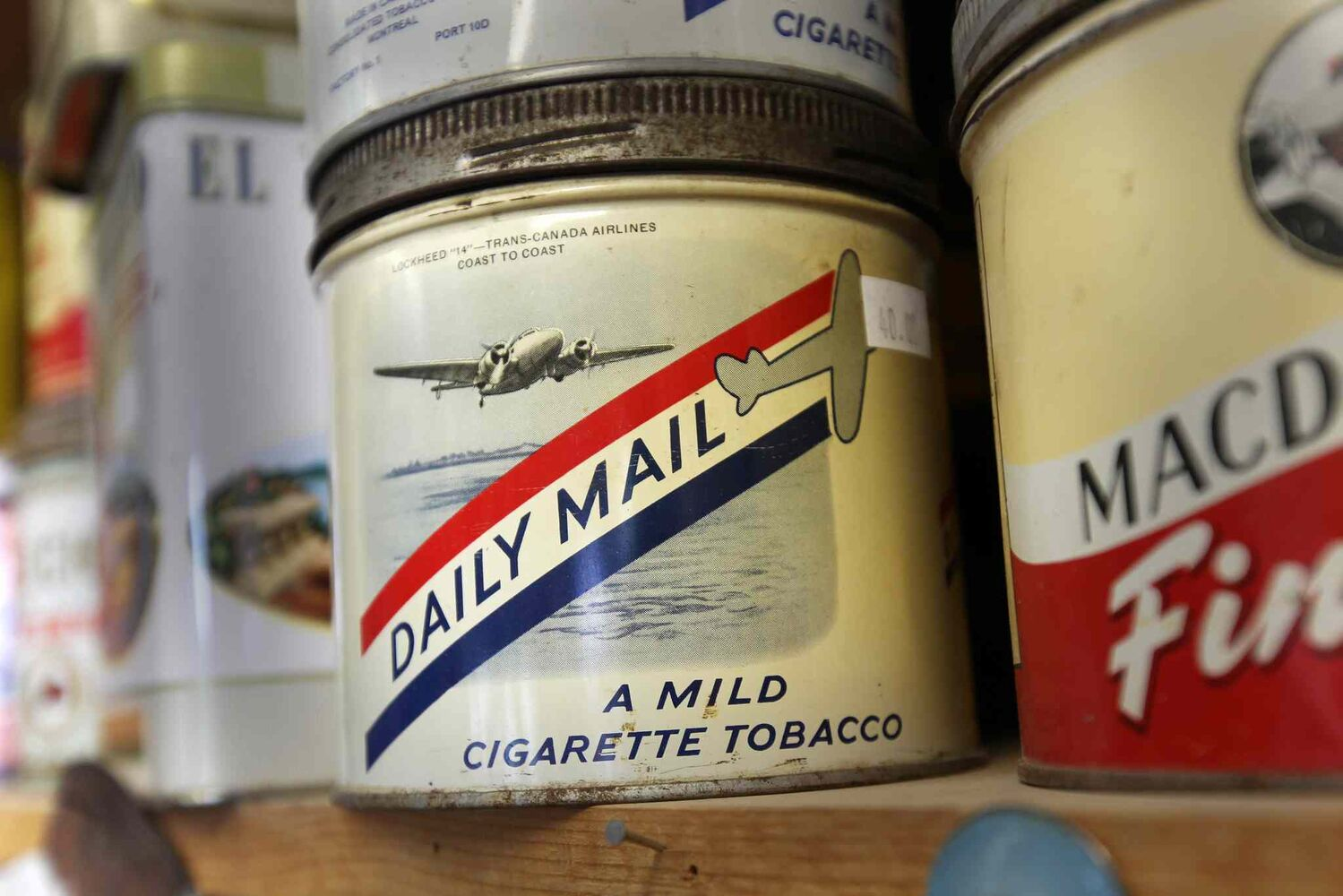 Lots of old tobacco tins for sale. Vivian Proden owns Junk for Joy just East of  Portage La Prairie, Manitoba on Hyw. #1 - Vivian, 84, is retiring after 34 years in the junk business and is having a 50% off sale starting this Friday.  ((JOE BRYKSA / WINNIPEG FREE PRESS))