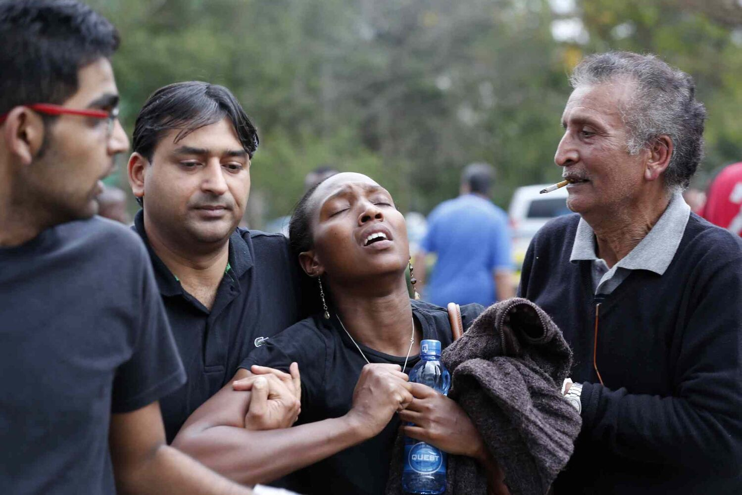 A woman is rescued from the Westgate Mall in Nairobi, Kenya on Saturday after a gun battle inside the shopping centre left at least 39 people dead after terrorists attacked one of the city's most exclusive malls.