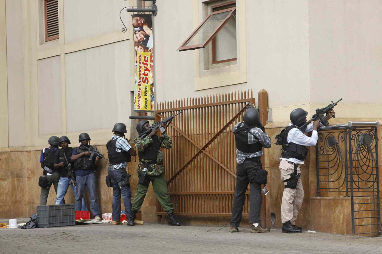 Armed special forces aim their weapons at the Westgate Mall in Nairobi, Kenya, Saturday after gunmen threw grenades and opened fire during an attack that left multiple dead and dozens wounded. A witness to the attacks on the upscale shopping mall says that gunmen told Muslims to stand up and leave and that non-Muslims would be targeted. (Khalil Senosi / The Associated Press)