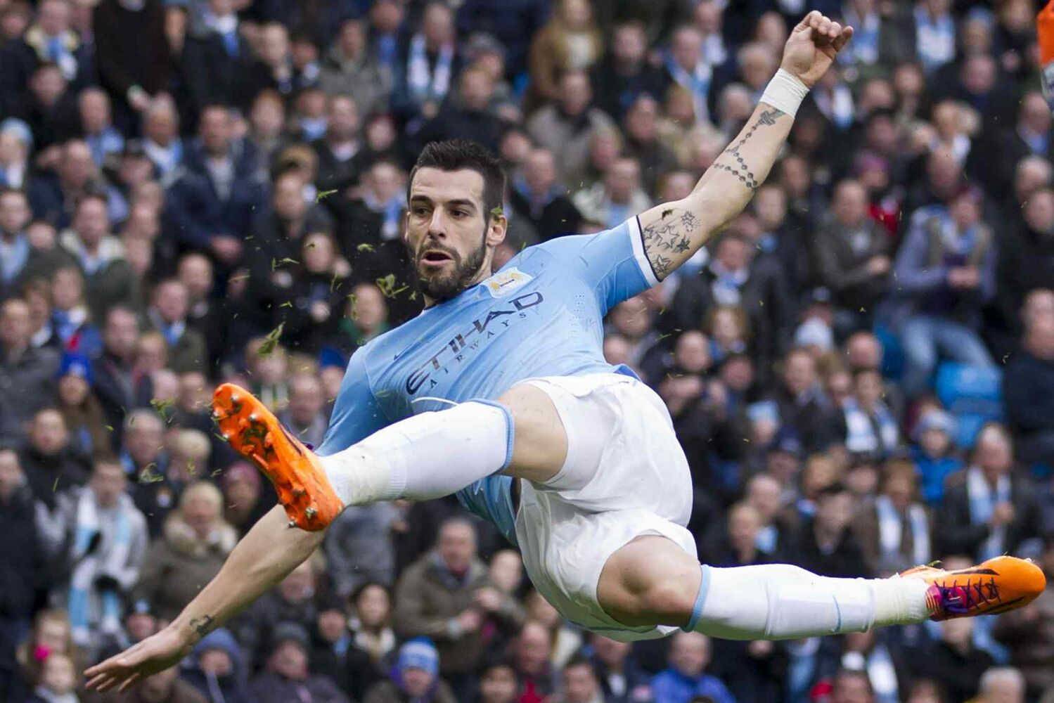 Manchester City's Alvaro Negredo scores against Tottenham Hotspur during an English Premier League soccer match at the Etihad Stadium, Manchester, England on Sunday.