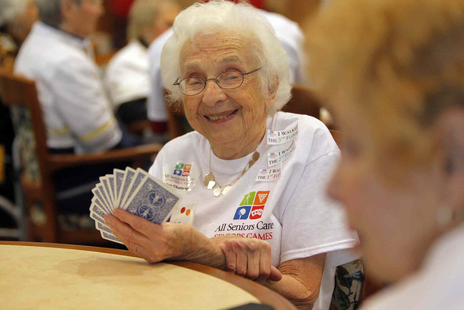 Roslyn Silver smiles as she play bridge during the All Senior Care Senior Games 2014 at Shaftesbury Park Retirement Residence.    (Boris Minkevich / Winnipeg Free Press)