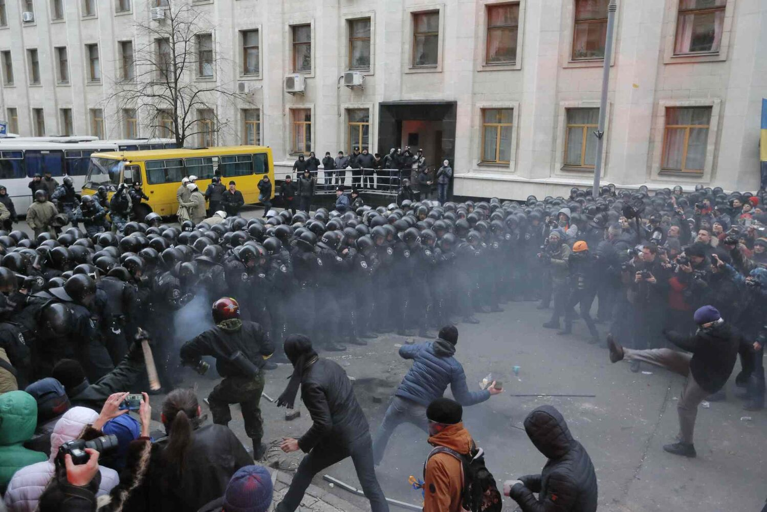 Protesters clash with police at the presidential office in Kiev, Ukraine, on Sunday, Dec. 1, 2013. As many as 100,000 demonstrators chased away police to rally in the center of Ukraine's capital on Sunday, defying a government ban on protests on Independence Square, in the biggest show of anger over the president's refusal to sign an agreement with the European Union.