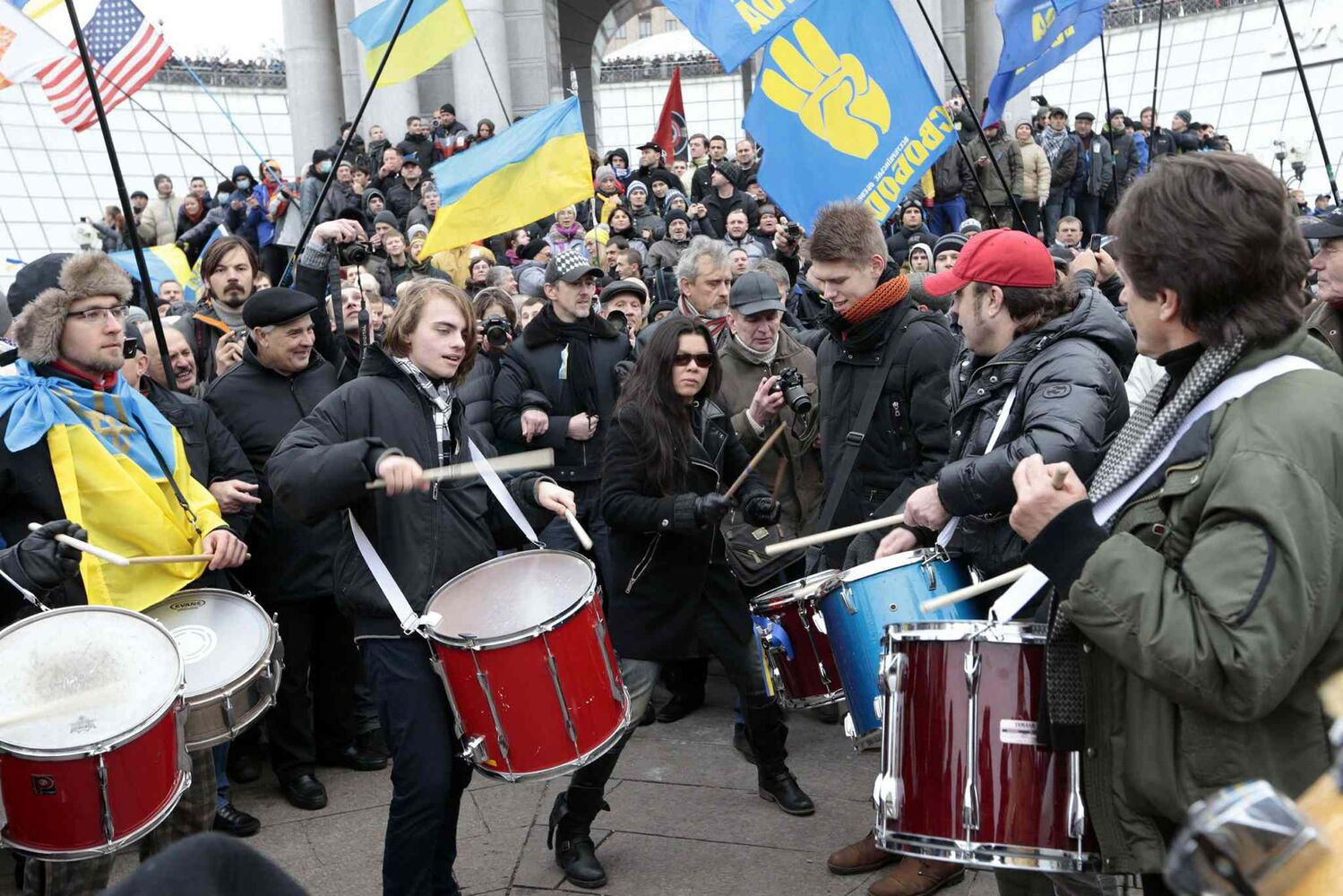 Demonstrators dance and play drums during a rally in downtown Kiev, Ukraine, on Sunday. As many as 100,000 demonstrators chased away police to rally in the center of Ukraine's capital on Sunday, defying a government ban on protests on Independence Square, in the biggest show of anger over the president's refusal to sign an agreement with the European Union.