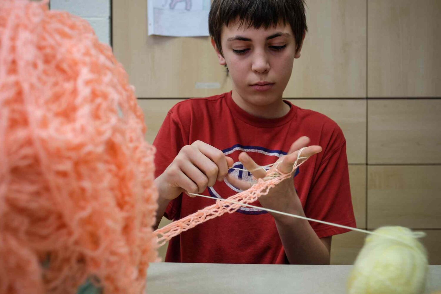 Adrien Wall, 11, displays his ball of finger-knitted yarn. He plans on knitting a six-kilometre length of the yarn in an effort to break a world record. He currently has about 396 metres of finger-knitted yarn.  (MIKE DEAL / WINNIPEG FREE PRESS)