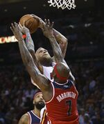 Washington Wizards' Al Harrington (7) is unable to block Miami Heat's Chris Andersen (11) during the first half of an NBA basketball game, Monday, March 10, 2014, in Miami. (AP Photo/J Pat Carter)