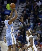 Denver Nuggets guard Arron Afflalo (10) shoots over New Orleans Pelicans forward Dante Cunningham (44) during the second half of an NBA basketball game in New Orleans, Wednesday, Jan. 28, 2015. The Nuggets won 93-85. (AP Photo/Gerald Herbert)