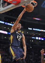 New Orleans Pelicans center Alexis Ajinca dunks during the first half of an NBA basketball game against the Los Angeles Lakers, Wednesday, April 1, 2015, in Los Angeles. (AP Photo/Mark J. Terrill)