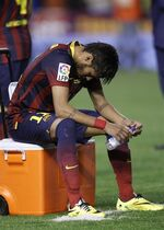 Barcelona's Neymar sits after Real Madrid won the final of the Copa del Rey between FC Barcelona and Real Madrid at the Mestalla stadium in Valencia, Spain, Wednesday, April 16, 2014. (AP Photo/Alberto Saiz)