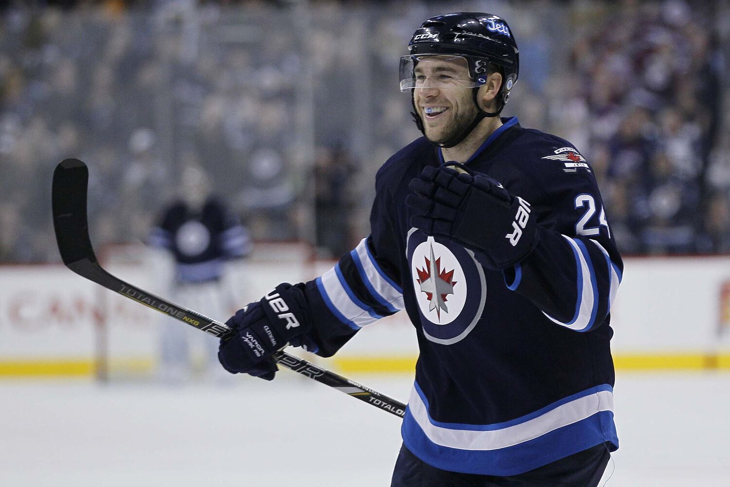Winnipeg Jets' Grant Clitsome (24) celebrates his goal against the San Jose Sharks during the second period.